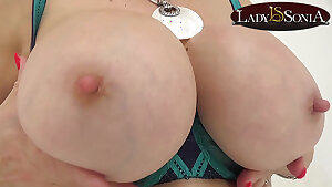 Lady Sonia shows off her thick plump breasts