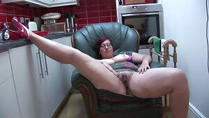 Big-boobed BBW Milf Jayne L in pantyhose does striptease and toy play