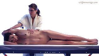 Brunette babe Adrien's first massage