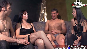 German first-timer couple at swinger party with wife and girlfriend