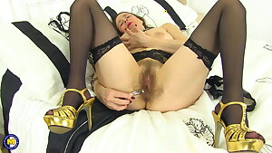 Hairy mother fucks her pussy hard