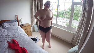 Wife tries on new swimsuit